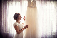 Wedding dress. Birde loving the wedding dress stock images