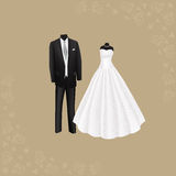 Wedding dress and black men's suit Stock Image