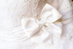 Wedding dress bow. A close up of a wedding dress with a large silk bow Royalty Free Stock Photography