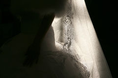 Wedding dress the bride in a back light of the sun indoors Stock Image