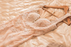 Wedding dress. Of the bride is lying on the bed Stock Photos