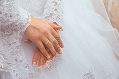 Wedding dress and bride's hands ring Royalty Free Stock Images