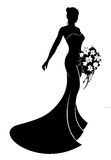 Wedding Dress Bride Silhouette. Bride in silhouette wearing a bridal dress wedding gown holding a bouquet of wedding flowers Stock Images