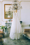 Wedding dress on the chandelier Stock Photo