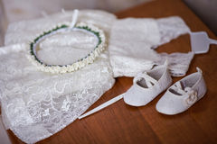 Wedding dress for child on wooden table.  royalty free stock photo