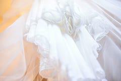 Wedding dress upward close up. Wedding dress close up. Blush Wedding Dress Skirt Detail Stock Image