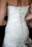 Wedding dress close-up. Closeup photo of beautiful bride's back in wedding dress Stock Photo