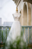 Wedding dress. Close-up on white wedding humanoid bracket Royalty Free Stock Images