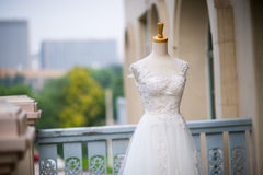 Wedding dress. Close-up on white wedding humanoid bracket Royalty Free Stock Photography