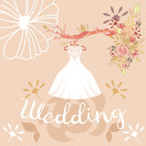 Wedding dress, colorful flowers and lettering. Bridal dress hanging on hanger with floral elements.The composition of wedding dress, colorful flowers and Stock Image