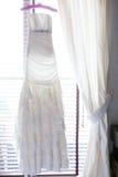 Wedding dress on a custom hanger Royalty Free Stock Photography