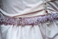 Wedding dress detail. Beautiful  wedding pink dress detail with pearls Stock Photo