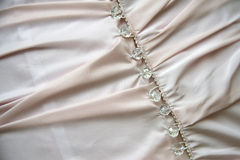 Wedding dress detail. Beautiful  wedding pink dress detail with bottoms Royalty Free Stock Images