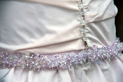 Wedding dress detail. Beautiful  wedding pink dress detail with pearls Royalty Free Stock Photography