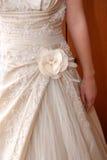 Wedding dress detail. Rose detail on the wedding dress Royalty Free Stock Photography