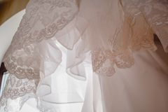 Wedding dress detail - close-up photo. Beautiful lace and details of the dress Royalty Free Stock Image