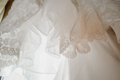 Wedding dress detail - close-up photo. Beautiful lace and details of the dress Stock Photography