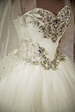 Wedding dress. Detail-63. Detail of a wedding dress decorated with crystals and veils Royalty Free Stock Photography