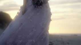 Wedding Dress with flowers at sunset - Slow Motion stock footage