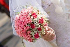 Wedding dress and flower bouquet Royalty Free Stock Photos