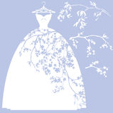 Wedding dress with flower branches Stock Photos