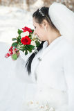 Wedding dress and flowers. Portrait of the bride with a bunch of flowers, in a wedding dress Royalty Free Stock Photography