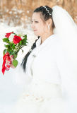 Wedding dress and flowers veil. Portrait of the bride with a bunch of flowers, in a wedding dress Stock Photography
