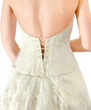 Wedding dress - a foreshortening from a back Royalty Free Stock Photography
