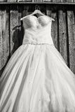 Wedding dress. In front of an old wooden wall Royalty Free Stock Images