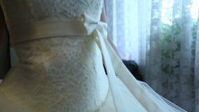 Wedding dress. Girlfriend helps the bride wear a wedding dress stock video footage