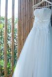 Wedding dress hang on bamboo wall Stock Photography