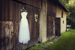 Wedding dress. Hanged on barn stock image