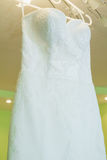 Wedding dress on a hanger Stock Photo