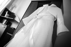 Wedding dress hanging Stock Photos