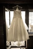 Wedding dress hanging above door Royalty Free Stock Photography