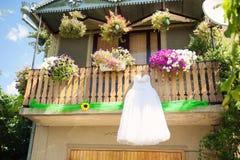 Wedding Dress Hanging at Balcony Royalty Free Stock Photo