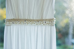 Wedding dress hanging at home Royalty Free Stock Photo