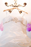 Wedding dress hanging on a shoulder Royalty Free Stock Image