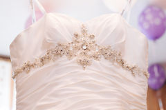 Wedding dress hanging on a shoulder Royalty Free Stock Photo