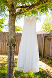 Wedding Dress Hanging in Tree Royalty Free Stock Photography