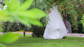 Wedding dress hanging. On the tree stock video footage