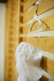 Wedding dress hanging up Royalty Free Stock Photo