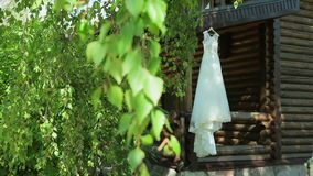 Wedding dress hanging. On the wall stock footage