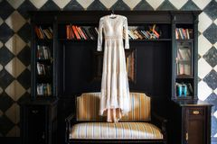 Wedding dress hanging on the wall in the room Stock Photography
