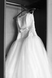 Wedding dress hanging in the wardrobe Stock Images