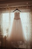 Wedding Dress Hanging Royalty Free Stock Photography