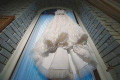 Wedding dress hanging in the window, lace Royalty Free Stock Image