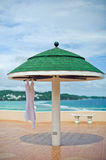 Wedding dress at the hotel on the background of the pool, ocean and mountains Stock Photo