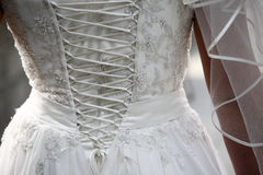 Wedding dress. Image of back of bride in wedding dress Stock Photo