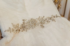 Wedding dress lying on a chair in the room Stock Photos